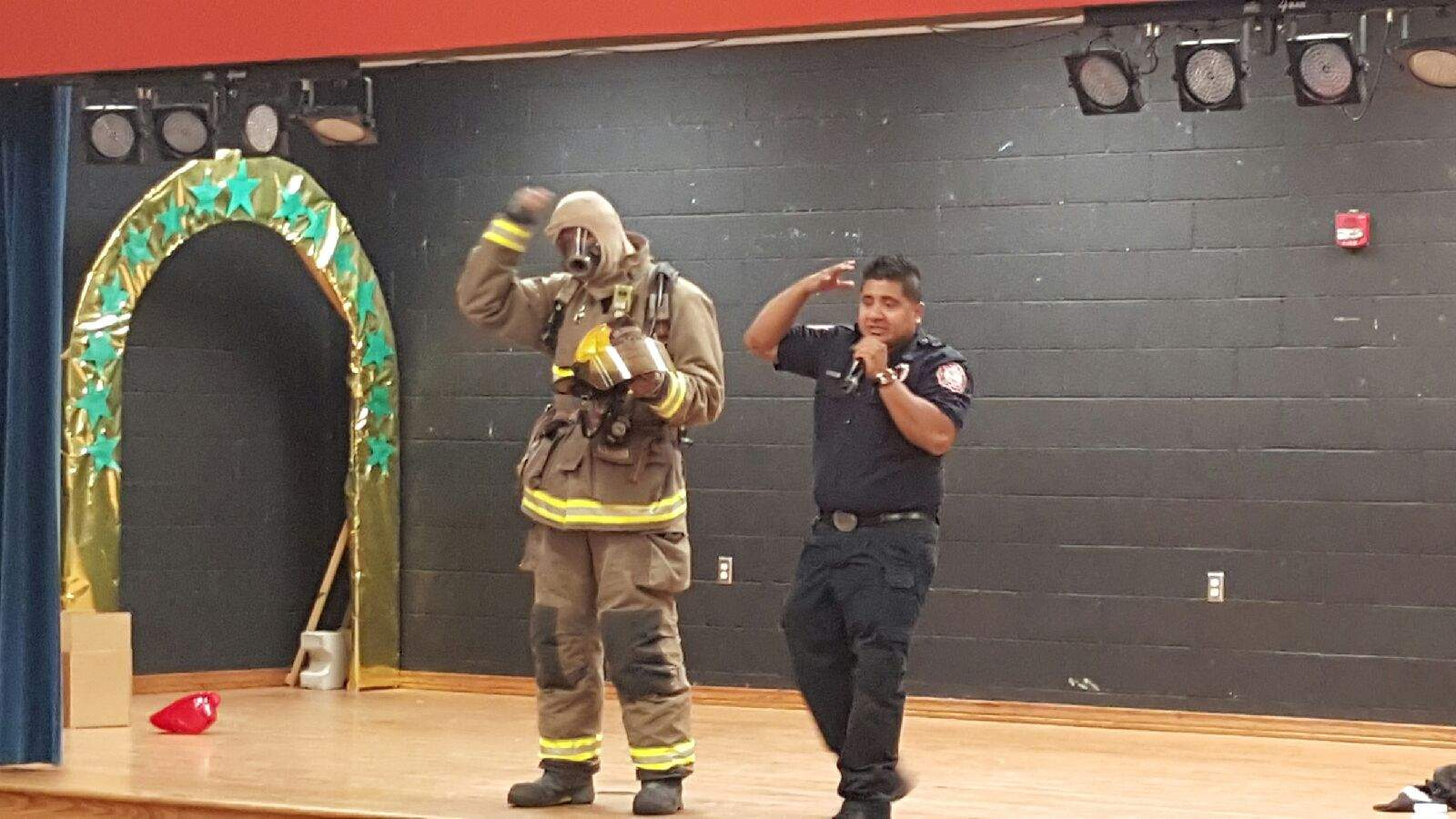 Firefighters demonstrate safety equipment