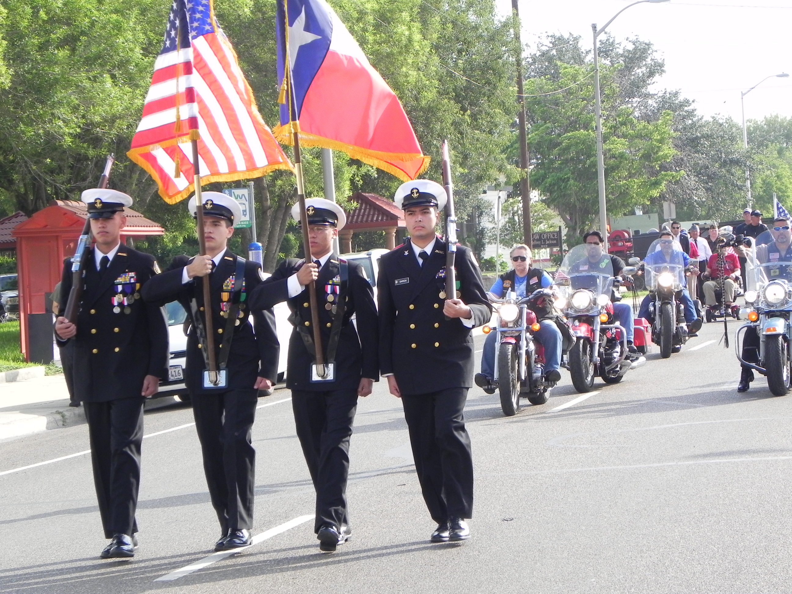 People in uniform participate in a parade