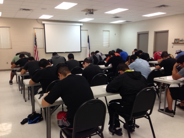 Firefighters attend a classroom training